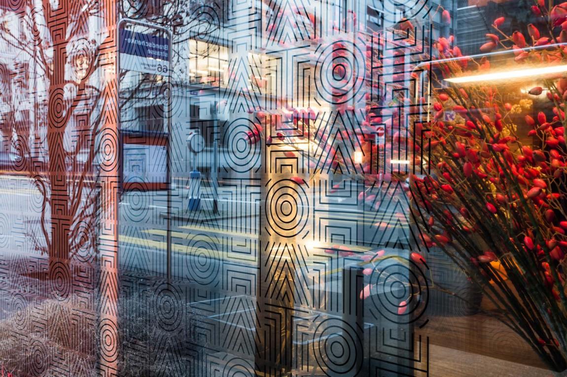Brand identity and window decals for fine dining Asian restaurant Hato designed by Allink, Switzerland